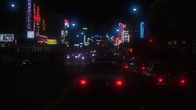 ms pov light color car moving toward transamerica building between traffic - 1980 stock videos & royalty-free footage