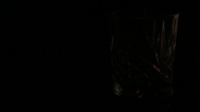 light fade off - cut glass whiskey tumbler - cut video transition stock videos & royalty-free footage