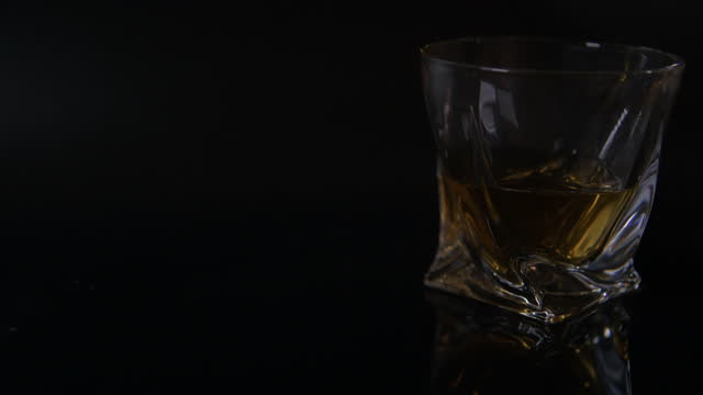 light fade off - modern tumbler filled with whiskey - fade out video transition stock videos & royalty-free footage