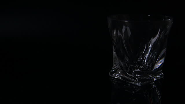 light fade off - modern whiskey tumbler - fade out video transition stock videos & royalty-free footage