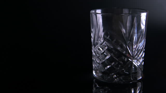 light fade on - cut glass tumbler filled with scotch whiskey - fade out video transition stock videos & royalty-free footage