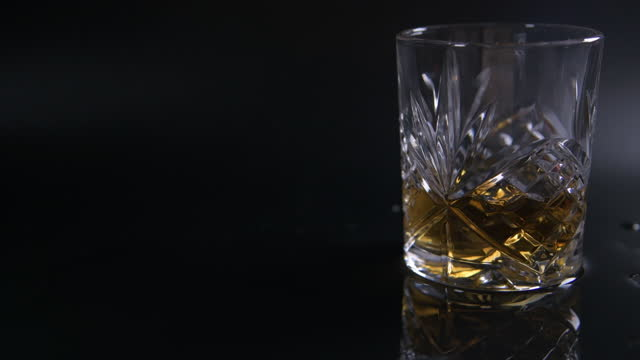 light fade on - modern tumbler filled with whiskey - fade out stock videos & royalty-free footage