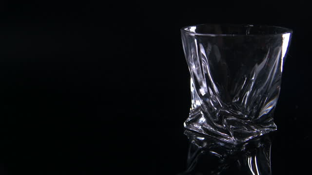 light fade on - modern whiskey tumbler - fade out video transition stock videos & royalty-free footage