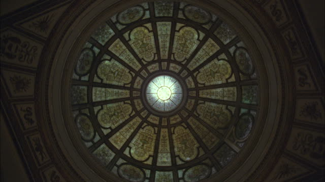 Light filters through the oculus of a dome.