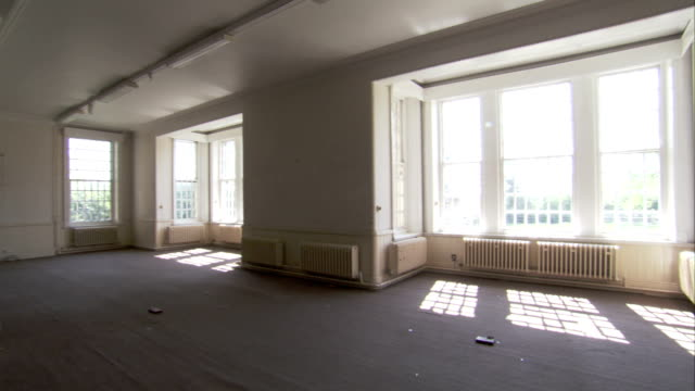 Light floods into a grand room inside High Royds former psychiatric hospital. Available in HD.