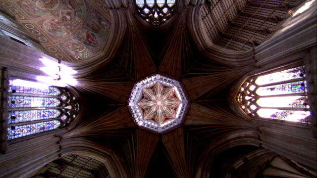 light floods through the stained glass windows in the tower of ely cathedral. available in hd. - octagon stock videos & royalty-free footage