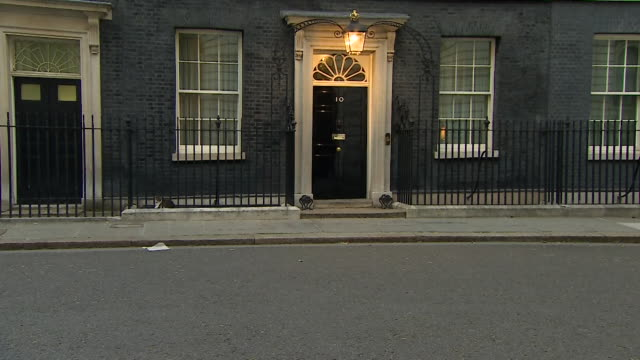 light going on outside 10 downing street westminster - dusk stock videos & royalty-free footage