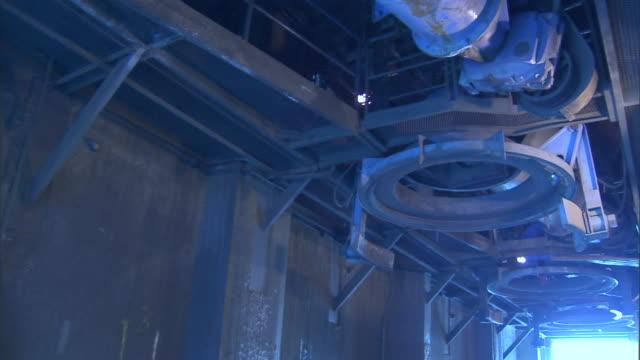 light illuminates a mine shaft pipe line. - mine shaft stock videos and b-roll footage