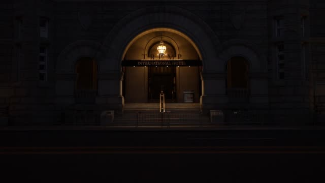 vidéos et rushes de light illuminates the outside of an entrance to trump international hotel on 12th street during the coronavirus pandemic on april 2 2020 in... - maryland état