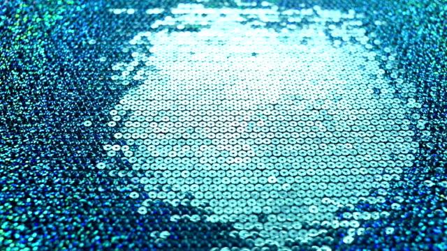 光の動きにブルーのメタルリング(ループ) - 金属点の映像素材/bロール