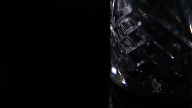 light moves over cut glass whiskey tumbler - cut video transition stock videos & royalty-free footage