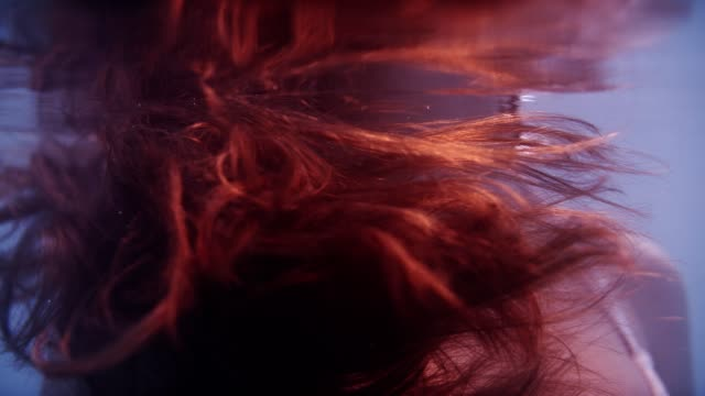 light moving on shiny brown hair underwater - siren stock videos & royalty-free footage