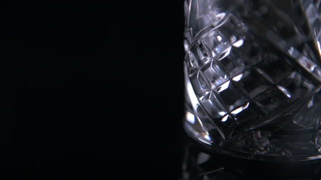 light moving over cut glass whiskey tumbler - cut video transition stock videos & royalty-free footage