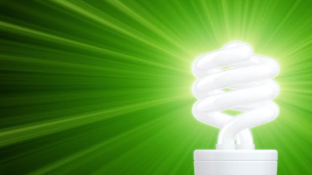 light of compact fluorescent lightbulb (hd1080) - compact fluorescent light bulb stock videos & royalty-free footage