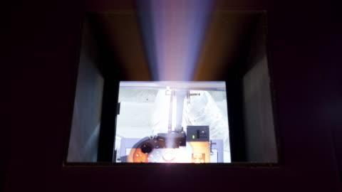 ms t/l light projection coming from theatre projection room/ hong kong - biosalong bildbanksvideor och videomaterial från bakom kulisserna