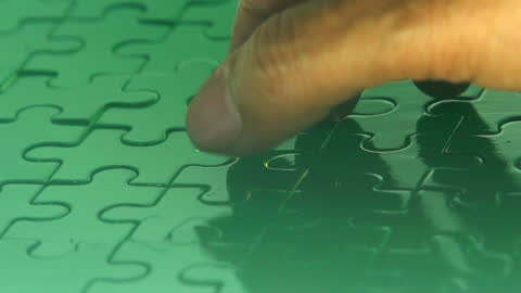 light puzzle putting the jigsaw puzzle filling by hand (chroma key) - putting stock videos & royalty-free footage