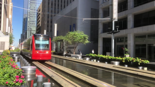 light rail running in downtown houston - tram stock videos & royalty-free footage