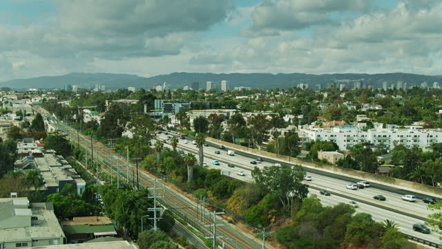 light rail tracks alongside i-10 between culver city and los angeles - drone shot - culver city stock videos & royalty-free footage