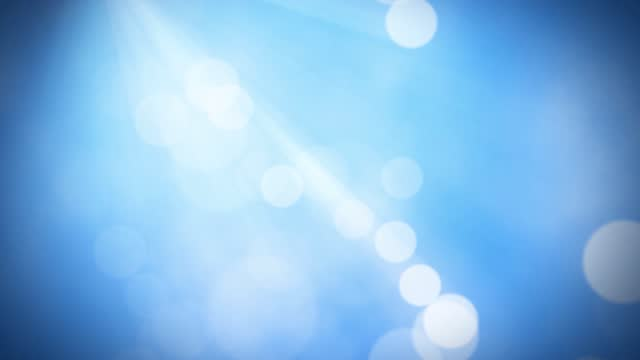 light rays and bokeh lights seamless loop animation - vignette stock videos & royalty-free footage