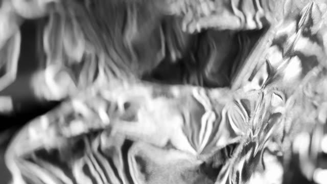金属的な質感の光の反射 - 銀点の映像素材/bロール