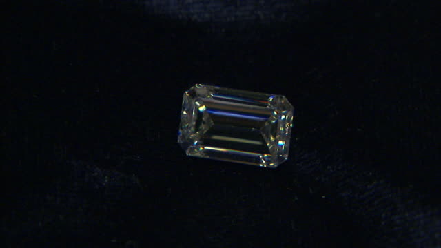 light reflects off a diamond on a piece of velvet. - gem stock videos and b-roll footage