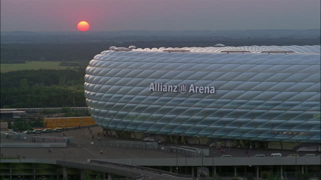 Light reflects on the rounded side of the Allianz Arena.