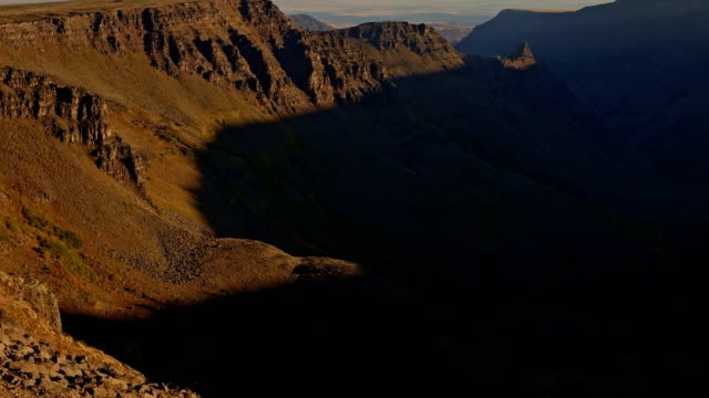 light reveals desert canyon scoured by glaciers at sunrise kiger gorge summit of steens mountain near malheur national wildlife refuge - wildlife conservation stock videos & royalty-free footage