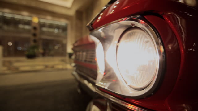 light shines from a cars headlight in las vegas. - collector's car stock videos and b-roll footage