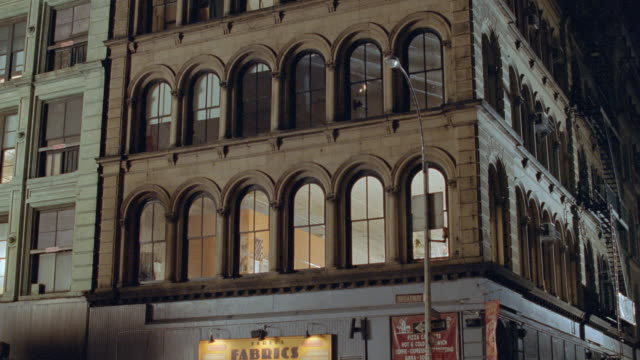 light shines from windows above a dance studio in new york city. - 2001 stock videos & royalty-free footage