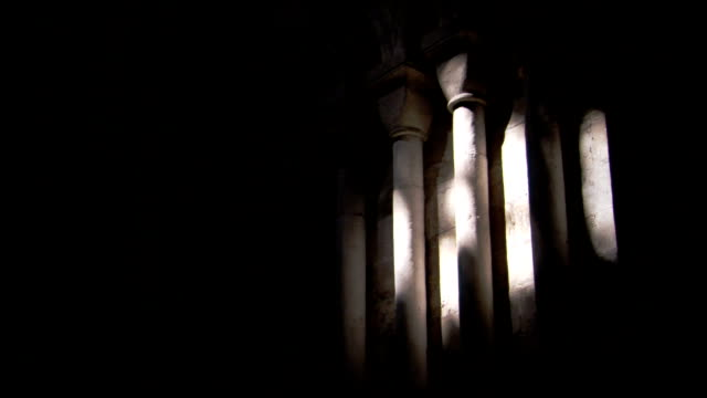 Light shines on a column in the Ely Cathedral. Available in HD.