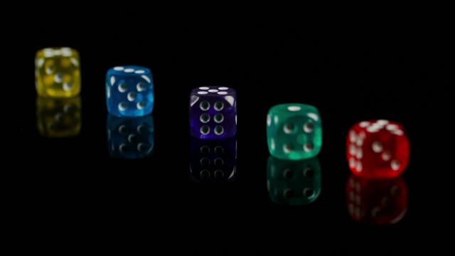 light shines on colourful dice - in a row stock videos & royalty-free footage