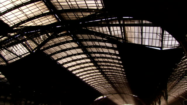 Light shines through the ceiling of London Paddington railway station. Available in HD.