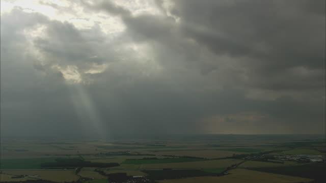 aerial light shining through clouds onto rural landscape, saxony, germany - ドラマチックな空模様点の映像素材/bロール