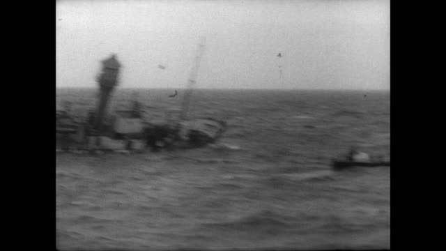 light ship newarp leaning over in the north sea / ship is towed by boat / boat begins to sink and remaining crew rescued / newarp disappears under... - 灯台船点の映像素材/bロール