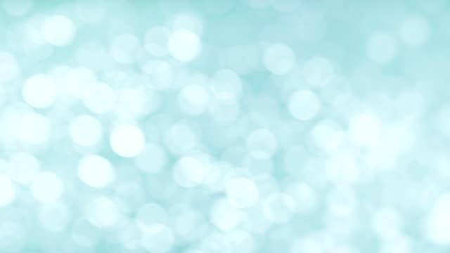 柔らかい水色ぼかしの背景 - グローワーム点の映像素材/bロール