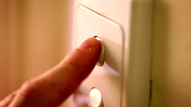 light switches - turning on (multi-shots with high quality audio) - electrical component stock videos & royalty-free footage