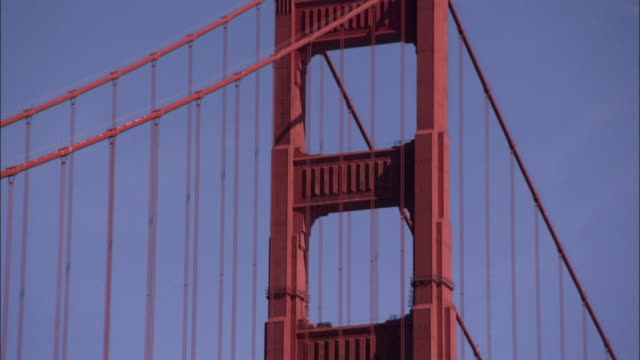 light traffic crosses the golden gate bridge. available in hd. - golden gate bridge stock-videos und b-roll-filmmaterial