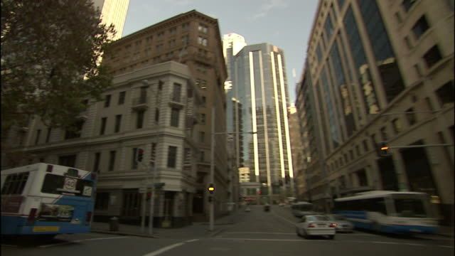 light traffic flows along city streets in downtown sydney. - car point of view stock videos & royalty-free footage