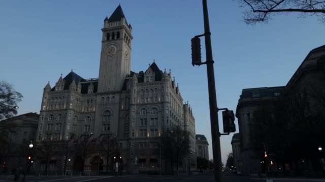 light traffic goes by outside trump international hotel on the corner of 12th street and pennsylvania avenue during the coronavirus pandemic on april... - pennsylvania avenue video stock e b–roll