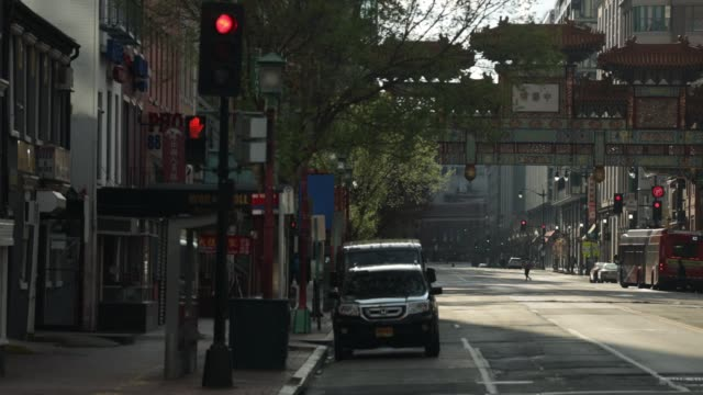 light traffic is seen on h street in chinatown april 1, 2020 in washington, dc. the district of columbia has joined other states and territories,... - maryland stato video stock e b–roll