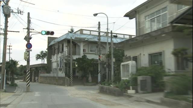 Light traffic moves through Sonai neighborhoods on Yonaguni Island, Okinawa.