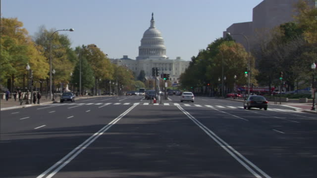 light traffic moves toward the united states capitol. - washington dc stock videos & royalty-free footage
