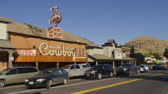 Light traffic passes the Million Dollar Cowboy Bar in Jackson Hole, Wyoming.