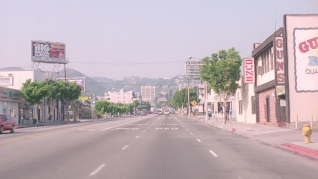 light traffic travels north on la brea avenue past santa monica boulevard in hollywood, california. - santa monica blvd stock videos & royalty-free footage