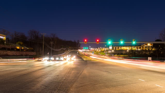 light trails of cars on the highway - traffic time lapse stock videos & royalty-free footage