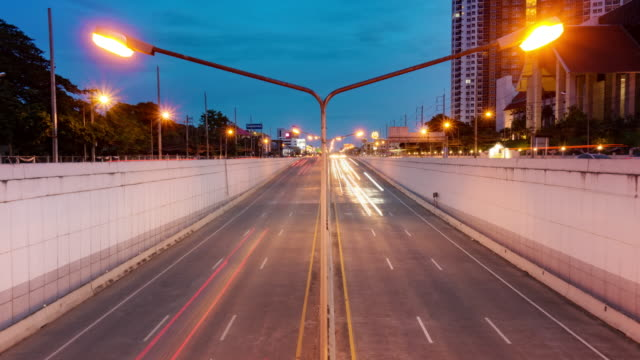 light trails traffic road in chiang mai city at night - chiang mai city stock videos and b-roll footage