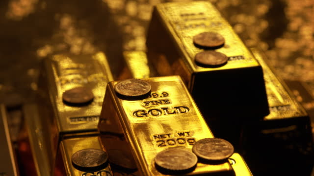 light transition over gold bars - coin stock videos & royalty-free footage