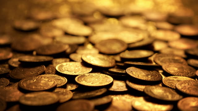 light transition over gold coins - coin stock videos and b-roll footage