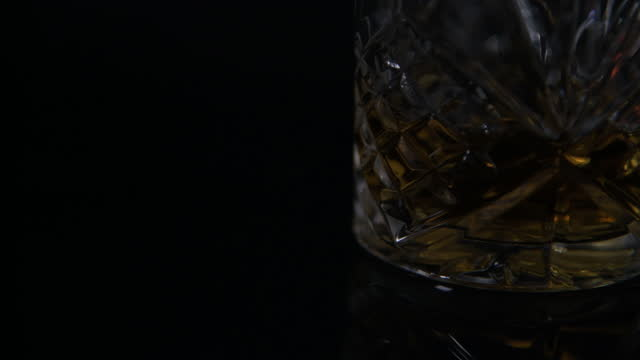 light turn on - cut glass tumbler filled with scotch whiskey - cut video transition stock videos & royalty-free footage