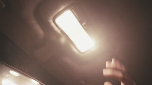 light up your car at night. car pov driving in snow at night. light up the led light in the car. - compact fluorescent light bulb stock videos & royalty-free footage